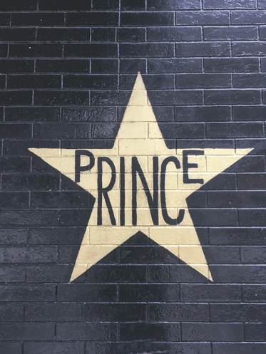 Photograph of Prince's star on the wall of the First Avenue nightclub in Minneapolis by Lizzy Shramko. Reproduced with permission.